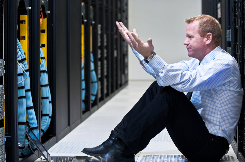 Frustrated Man in Data Center
