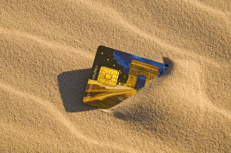 credit card in sand
