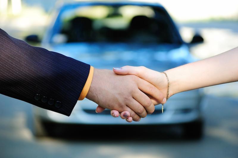 Handshake on car buy
