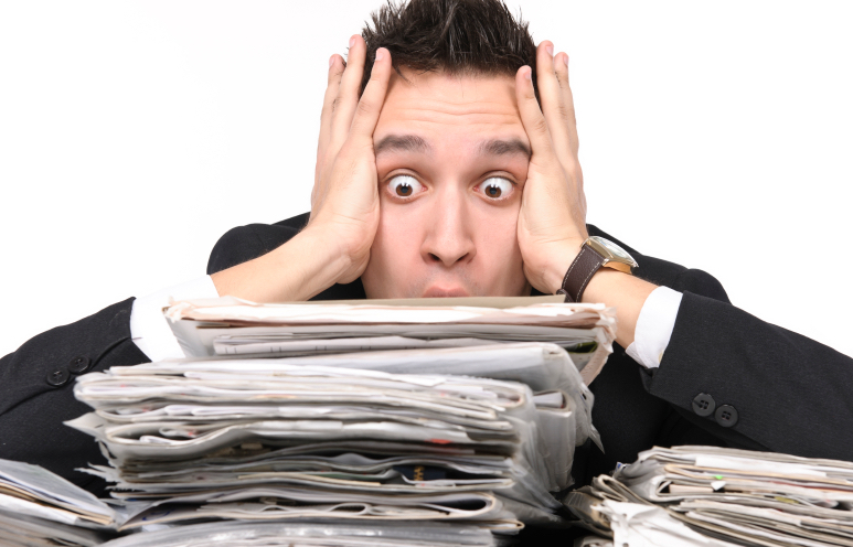 Business owner overwhelmed by paperwork
