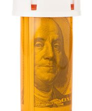 Getty Images - $100 in pill bottle