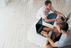 GettyImages-men with laptops on floor