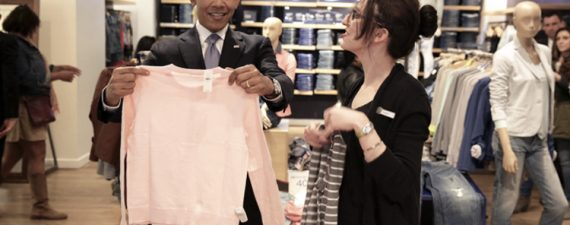 President Barack Obama looks at a sweater with Gap employee Susan Panariello while shopping for his family in New York