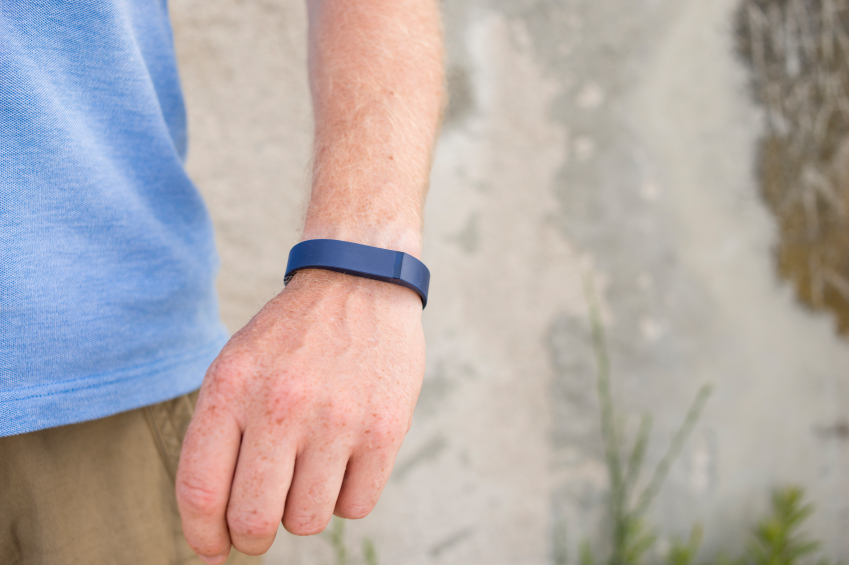 Wearning a Fitbix Flex Activity and Sleep Tracker