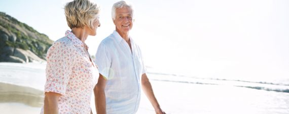 Shot of a senior couple walking on the beach