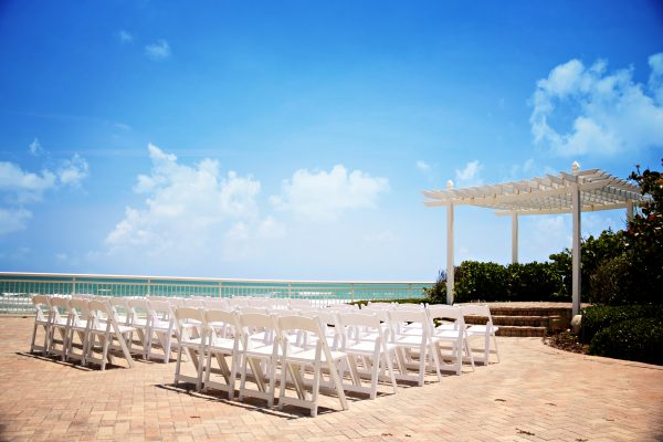 Matthew negotiated the beachside ceremony site fee from $2,000 to $500.