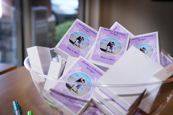 The couple gave playing cards featuring their engagement photos as wedding favors.
