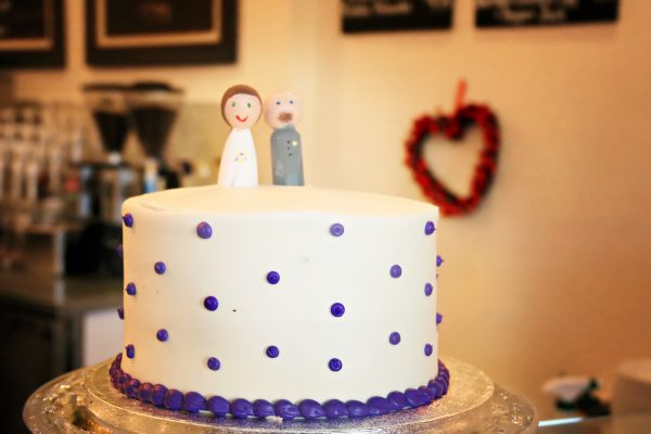 The Verlegers bought a cake and cupcakes from a high-end grocery store. Brittany made the cake toppers in the couple's likeness. Total dessert costs: $60.