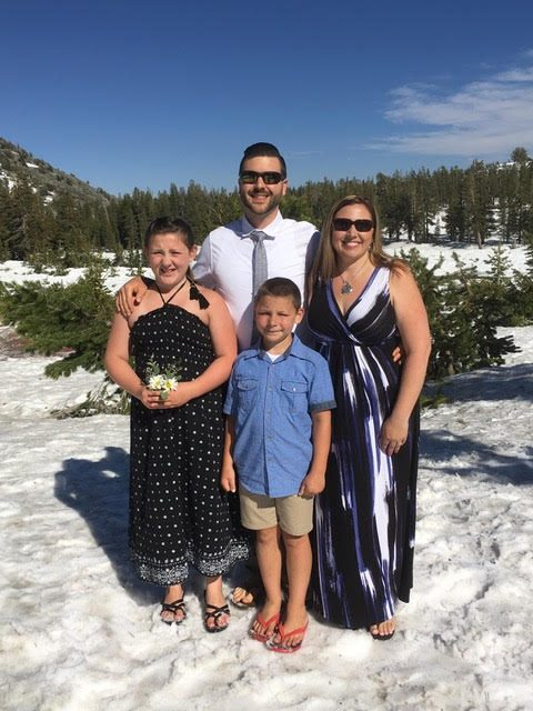 The Bryants pose in flip-flops in the snow after a vow renewal ceremony moved from the beach to the mountain to escape crowds.